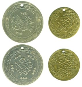 original_coin_and_replica_used_as_ornaments